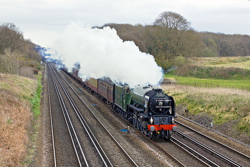 4th Apr 12:  On a cold day with intermitant spots of rain 60163 Tornado races west between Winchfield and Hook while working 1Z56 from Peterborough to Salisbury.
