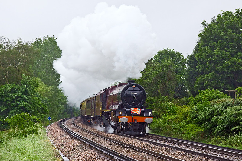 3rd Jun 12:  The Jubilee Special in the hands of 6201 Princess Elizabeth  from Solihul to Kensington Olympia looks and sounds terrific as it climbs away from Wokingham.