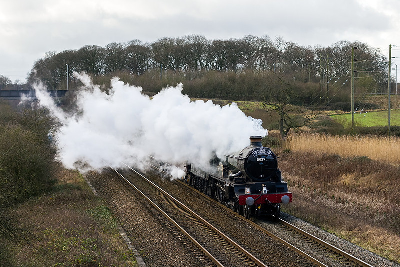 9th Jan 14:  GWR Castle 5029 'Nunney Castle' at Berkley Marsh when  working from Bishop Lydiard to Southall.  I knew the wind would blow the steam this way but not by as miuch as this.  Had the sun stayed out I really would have be  peed off.