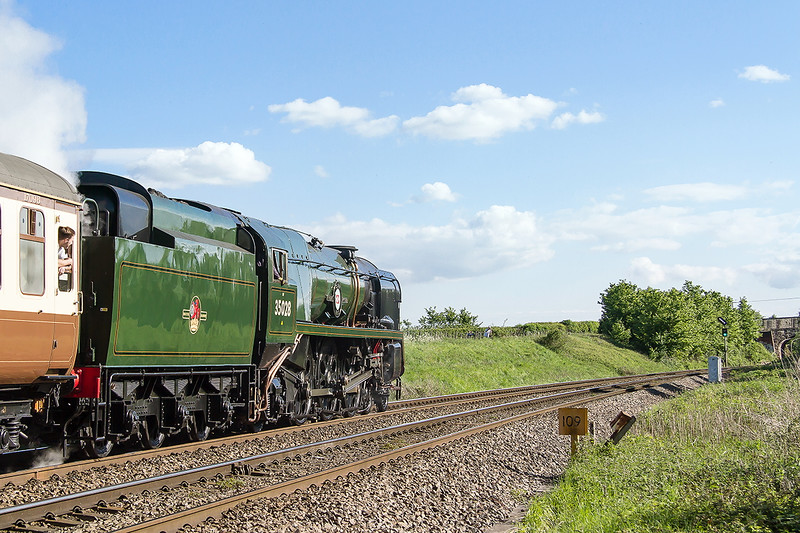 13th May 2015:  35028 'Clan Line' brings the Belmond British Pullman towards Hawkeridge Junction where the 'Feather' shows it will take the East Chord to gain the Berks & Hants line.  It will continue the journey back to Victoria via Reading and Staines