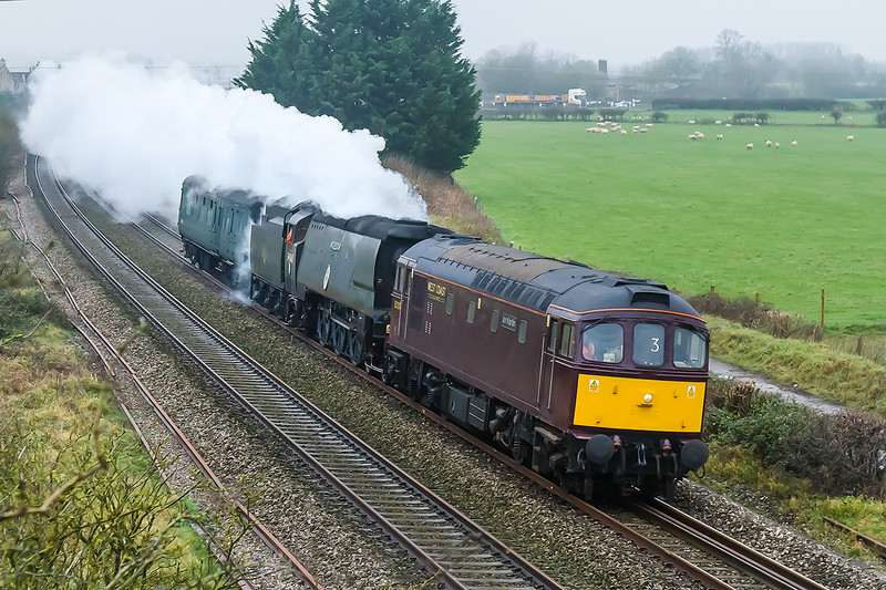 13th Dec 2015:  33207 'Jim Martin' does the honours on 5Z67 from St Philips Marsh to Southall. With 34067 'Tangmere' and it's support coach in tow they are pictured near Thingley Junction.  Shame about the weather !