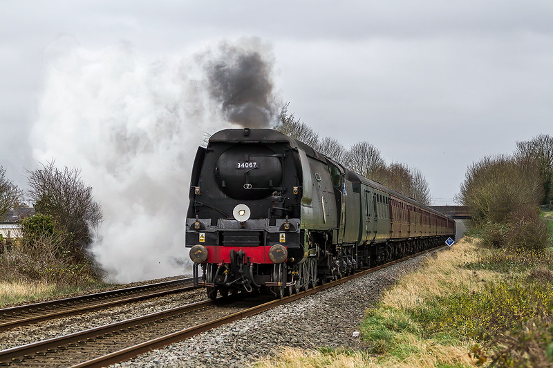 5th Dec 2015:  In a very strong wind 34067 'Tangmere' runs north through Wylye hesding for Bath with a Christmas Special from Haywards Heath.  47832 was riding shotgun at the rear