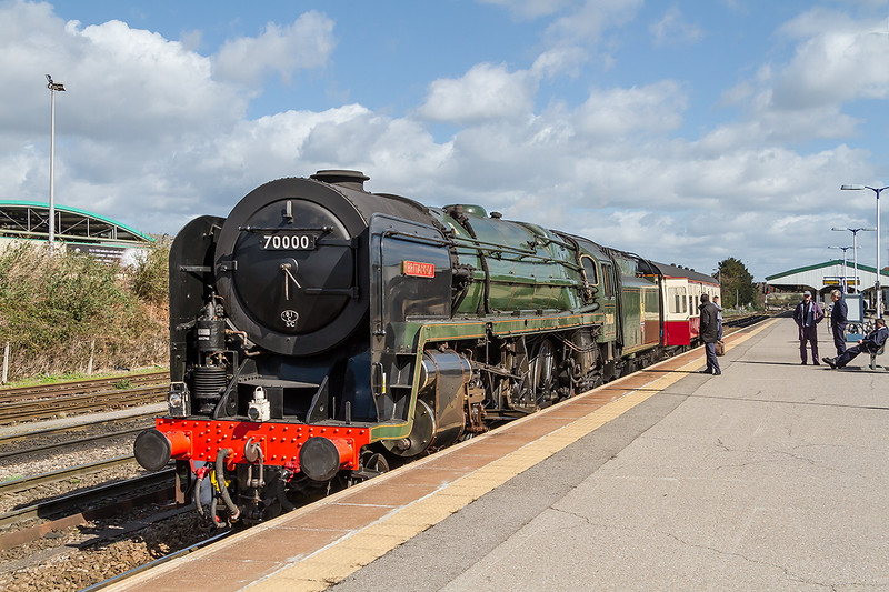 31st Mar 2015:   A very welcome surprise was  70000  'Britannia'  running early so it could not run through Platform1 as planned because it was blocked.  Captured here in Platform 3, with crew taking a breathe,r as they wait for the Pompey train to clear the section and so continue the trip from Minehead to Swanage for the Gala