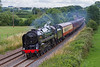 25th Jul 2015:  70000  'Britannia' heads the West Somerset Steam Express from Paddington to Minehead down the grade through Great Cheverell