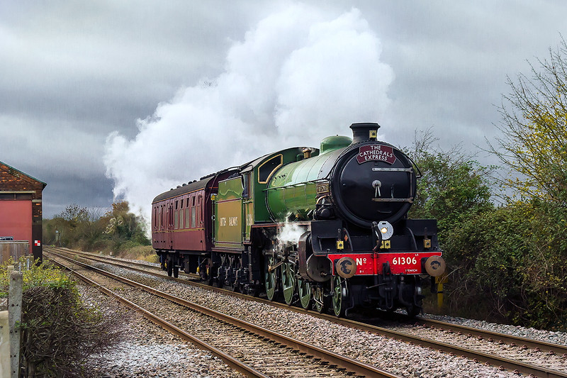 27th Nov 2015:  After a late arrival at Minehead the LNER B1 stayed overnight on the West Somerset Railway.  5Z31 is taking 61306 and the support coach back ro Southall.  Sounding good and going well the pair are pictured passing the old goods shed on the site of Edington & Bratton station