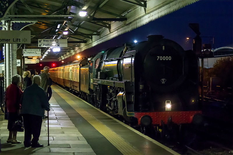 13th Sep 2015:   The seasons last 'Torbay Express' hauled by 70000 'Britannia' arriving at Westbury for a brief stop.  Running a bit late and with rain starting to fall the light had died causing the use of iso 3200