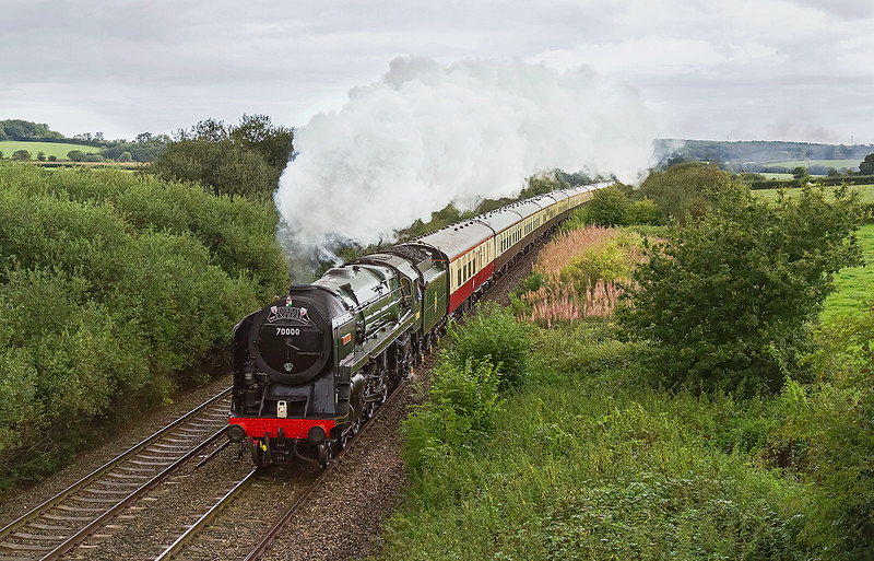 13th Sep 2015:  Powered by 70000 'Britannia' the last 'Torbay Express' 'of the season sounded superb as it pounded up the hill past Strap Lane near Bruton.  Unfortunateley although it was bright and almost sunny in Westbury it decided to rain in this part of Somerset.  B....r !