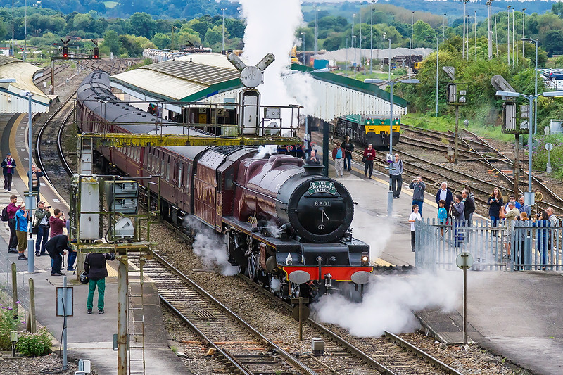20th Sep 2016:  Stopping for a crew change at Westbury is LMS Princess Royal pacific 6201 'Princess Elizabeth' (46201).  1Z88 is running from Exeter St Davids to Victoria but the train has actually started from Penzance at 9.14 am.  A long days work indead.  59001 is waiting in the loop with 7A15 and will follow the kettle up the Berks & Hants.  iso 1600 of course