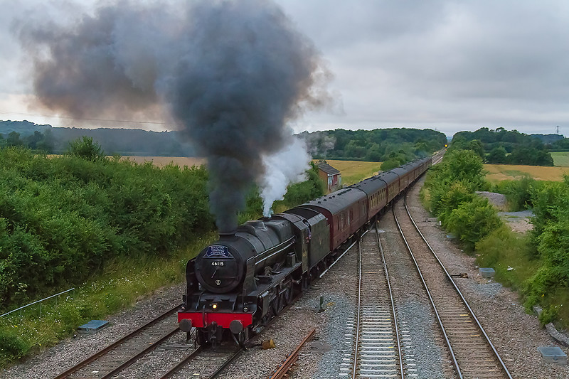 16th Jul 2016:  Having been held at the signal for nearly 8 minutes the  line clears and 46115 Scots Guardsman gets into its stride at Fairwood Junction. The light had died by then of course so iso 3200