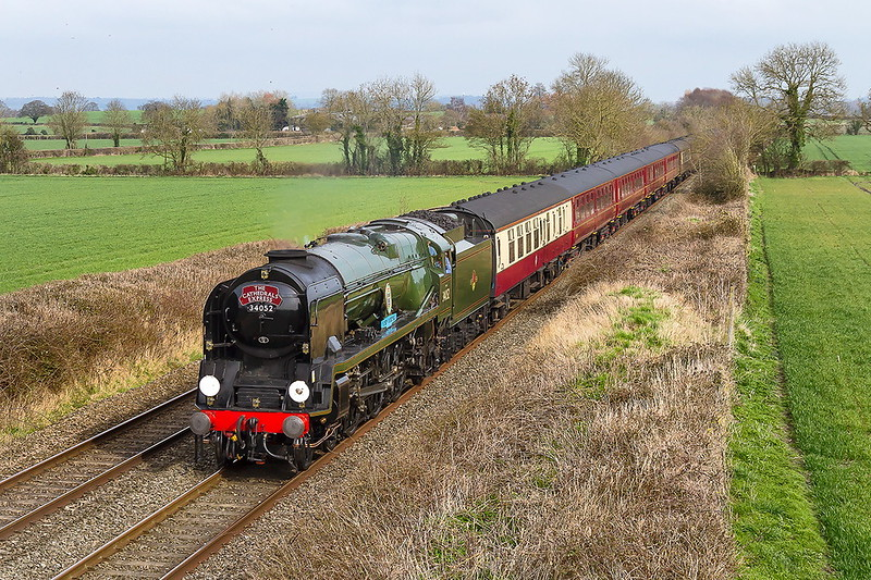 11th Mar 2017:  The day's Cathedrals Express is running foron Southend to Bristol Temple  Meads.  1Z24 is in the hands od 34052' Lord Dowding', actually 34046 'Braunton', is captured from Cowleaze Lane in Edington.  It was running  30 minutes late which was fortunate as by then the sun was out.  Sometimes you do win.