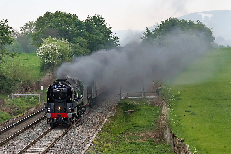 6th May 2017:  The day's leg of 'Great Britain X' tour is from Bristol Temple Meads to Plymouth powered  by 34052 Lord Dowding amd 46100 Royal Scot.  With the Battle of Britain leading the Scot 1Z46 is pictured just as it shuts off to slow for Fairwood Junction.  Earlier the discussion on the bridge was to try and guess which way the wind would blow the smoke.  As you can see I got it wrong.  I was not alone !!
