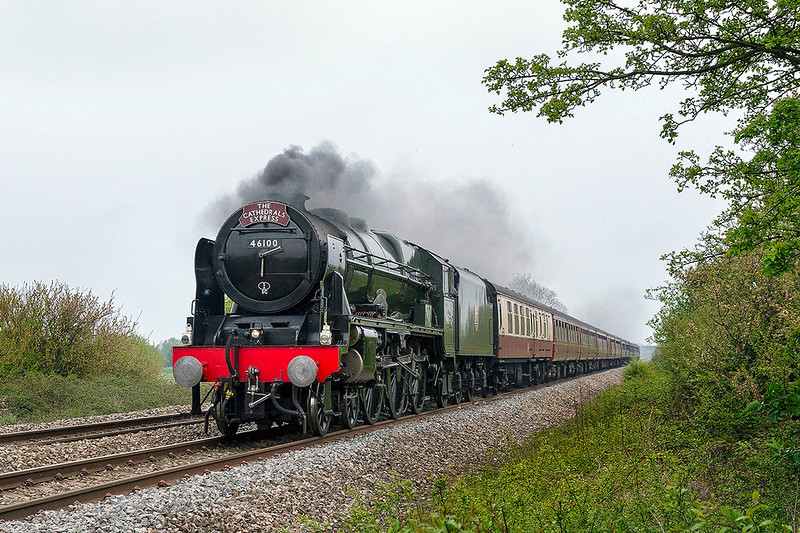 20th Apr 2017:  Having traversed the New Line, AKA Cut Off or Avoider,  LMR 4-6-0 46100 Royal Scot is going very well as it passes Masters Crossing inb Fairwood.  Unfortumnately 6Z60 running from Victoria to Minehead iwas due to go into Frome to allw a Paddington to Penzance Express to overtake and had therefore just shut off steam in preparation for the slow junction at Clink Road in Frome.Stll you cannot win them all.