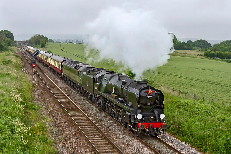 26th Jun 2019: On a relatively cold and damp morning 34046 'Braunton' 'Dorset Coast is leaving Westbury as it heads to Weymouth with 1Z26 the 'Dorset Coast Explorer' from Bristol Temple Meads.  At Yeovil Pen Mill Braunton will detach and go to the Junction where it can be turned and will then go LE to Weymouth and work the tran back to Bristol in the afternoon.  47501, tucked inside, will power the train,on to Weymouth and yhen be at the rear for the return working