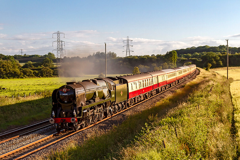 30th Jun 2019:  The 'English Riviera Express' with Southern Railway West Country Pacific 34046 'Braunton' providing thr urge is pictured as it accelerates away from Clink Road Junction after a Frome stop.  It is travelling from Kingswear to  Bristol Temple Meads