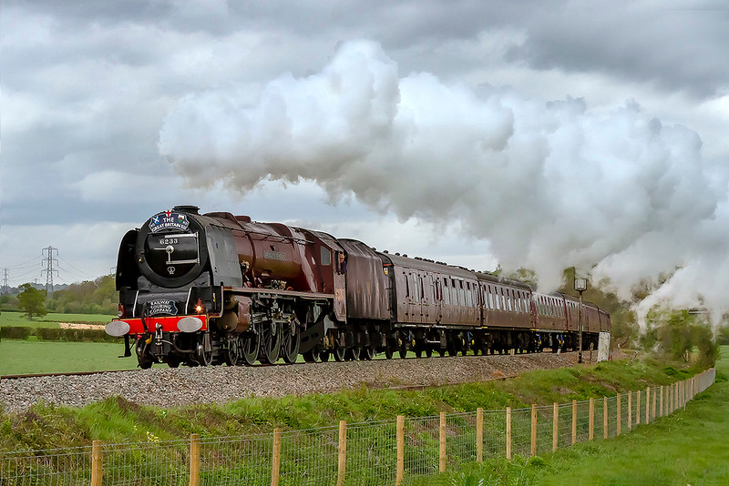 28th Apr 2019:  On the 2nd day of the GB XII rail tour 6233 'Duchess of Sutherland' is captured on the rise at Bunns Lane between Blatchbridge Junction and Whitham Friary.  1Z25 started from Plymouth at 09.45 and is heading for Minehead on the West Somerset Railway.  The route has included Bristol, Bath and Westbury.