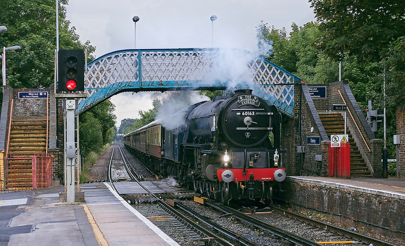 27th Jun 13:  Passing through Chertsey on a wet evening is 60163 Tornado working the return Cathedrals Express from Salisbuy to  Norwich