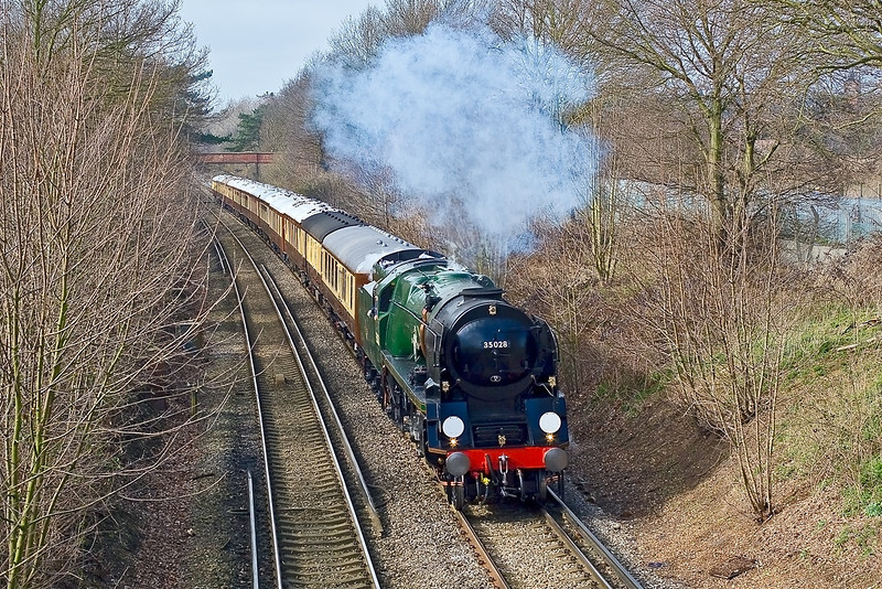 1st Mar 08:  The VSOE circular tour running from Victoria to Victoria via Haslemere and Eastleigh passes Lyne just as cloud took the edge from the sunlight.