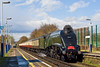 "11th Apr 08:  After thunder and heavy storms a very welcome patch of sun.  LNER A4 Pacific 60019 ""Bittern"" coasts through Addlestone Station.  The private charter started from Euston and would run to Victoria via Guildford and Redhill."
