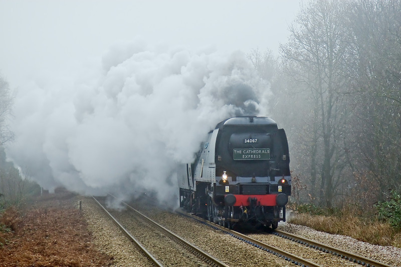16th Dec 08:  34067 'Tangmere' thunders up the hill through Sandhurst on the Cathex to Winchester.  On a foggy but windless day I had not expected the smoke to beat down like this.