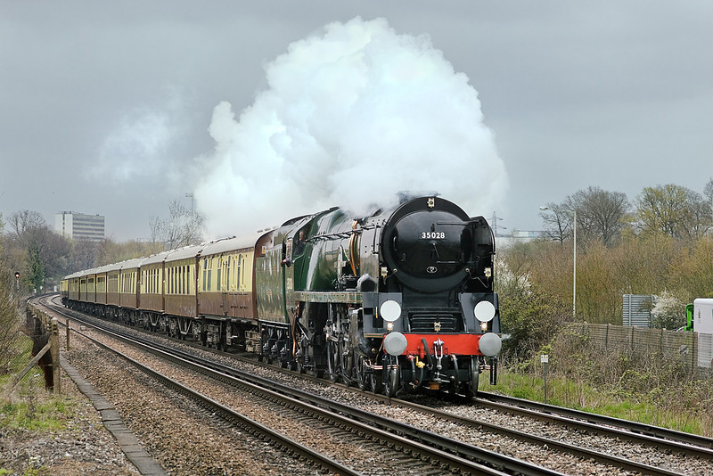 """14th Apr 10:  On a cold and dull morning Merchant Navy class Pacific 35028 """"Clan Line"""" powers through Bracknell taking the VSOE to Bristol from Victoria"""