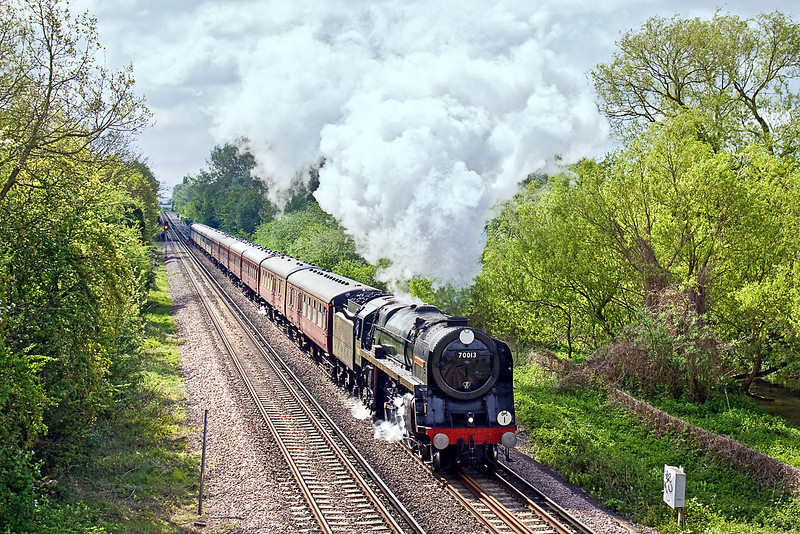 3rd May 10:  Accelerating away from Staines across Staines Moor is 70013 'Oliver Cromwell'.  1Z82  works from Victoria to Windsor and Eaton Riverside.