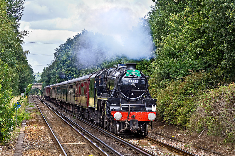"""5th Aug 10:  """"The Cathedrals Express"""" to Bristol with LMS Black 5  #44932 at the helm nears Addlestone under a nice big dark cloud !"""