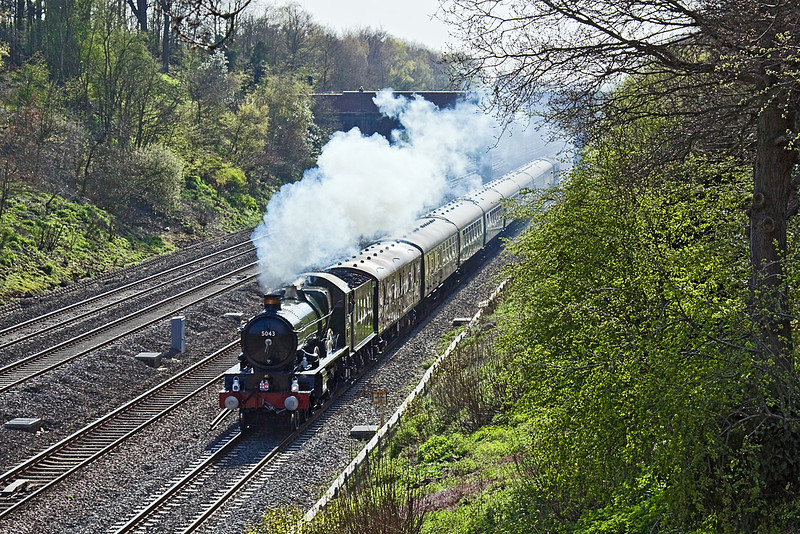 """16th Apr 10:  Working from Tyseley to Southall is 5043 """"Earl of Mount Edgecumbe"""" seen here passing through Ruscombe.  The first vehicle is a newly restored BR GUV parcels van which has been converted to iinclude additional water tanks for the Loco.  This will facilitate the non ston runs between Paddington and Bristol on the 17th April 2010.  These have been arranged in conjunction with First Great Western as part on the GWR 175 celebrations"""