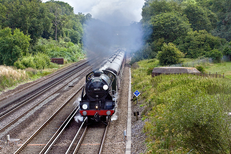 """18th Aug 10:  The"""" Dorset Coast Express"""" with 30777 """"Sir Lamiel"""" on the point accelerates away from the Winchfield water stop"""
