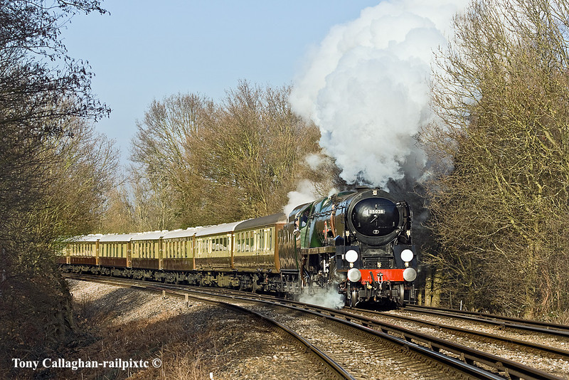 """21st Jan 10:  35028 """"Clan Line"""" opens up for the climb up into Byfleet & New Haw station from the Chertsey Loop. The Orient Express is running a Surrey Hills circular tour from Victoria."""