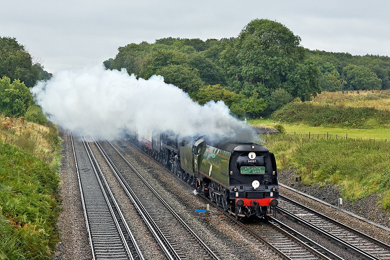 """4th Sep 11:  Booked to be hauled by 30777 """"Sir Lamiel"""" plans were changed after she failed on a transfer trip previously. 34067 & 70000 now double head 1Z92 """"The Atlantic Coast Express"""" all the way from Waterloo to Newquay via Salisbury and Bristol,  a journey of just over 315 miles.  Pictured on the Fast at Totters Lane between Winchfield and Hook"""