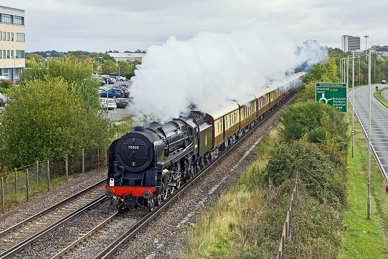12th Oct 11:  BR Standard Class 7 Pacific 4-6-2 70000 'Britannia' brings the Orient Express away from Bracknell,  1Z97 is traveling from Victroria to Bristol