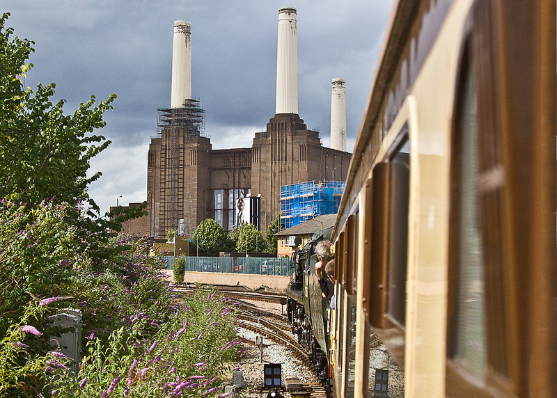 8th Jul 11:  Clan Line has passed under the LSWR main line and will shortly start the climb up to Grosvenor Bridge over the Thames and into Victoria.  Battersea Power Station looks on
