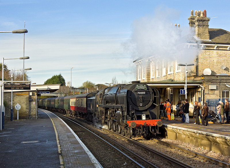 10th Dec 11:  Crowds gather to watch as 70000 'Britannia' arrives at Chertsey for it's planned water stop while on route from Southend to Winchester