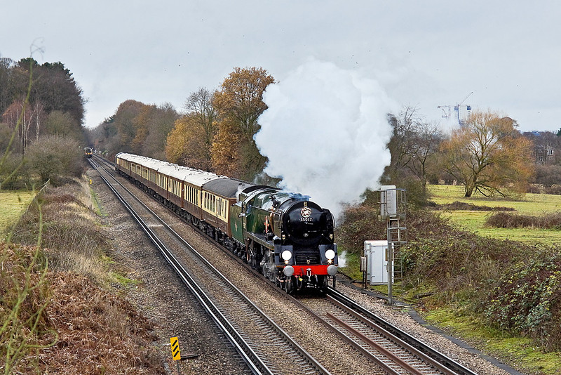 21st Dec 11:  For the last time in 2011 the VSOE Surrey Hills Luncheon Special blasts up the hill through Mayford.  Providing the grunt is the usual power in the form of 35028 Clan Line though on this occasion carrying the plates of 35017 Belgian Marine.  Less than 3 minutes later and the whole scene was bathed in winter sunshine.