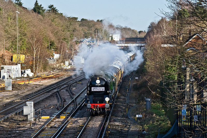 17th Jan 09:  Clan Line has just shut off as it passes Weybridge travelling from Victoria to Southampton Eastern Docks with the Orient Express set