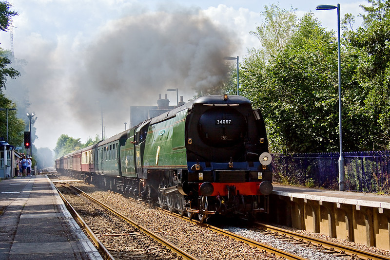 8th Aug 09:  The Surrey Downsman circular tour from Victoria is headed by 34067 Tangmere. Captured here really going for it through Chilworth on the 1 in 100 climb up to Gomshall from the water stop at Shalford