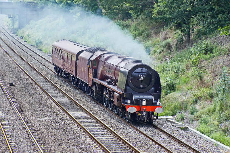 30th Jun 09:   LMS Pacific 6233 Duchess of Sutherland potters through the Sonning Cutting on it's way from Butterley to Ilford.