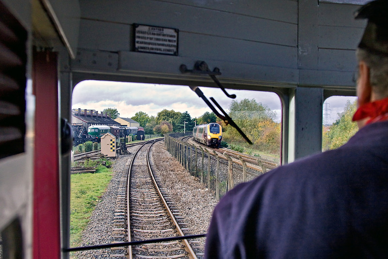 30th Oct 11:  A Cross Country Voyager on the East Chord at Didcot as it's fore runner the Steam Railmotor runs north on the main demonstration line.  Taken with permission while squashed between the compartment side and a very hot Top Feed pipe.