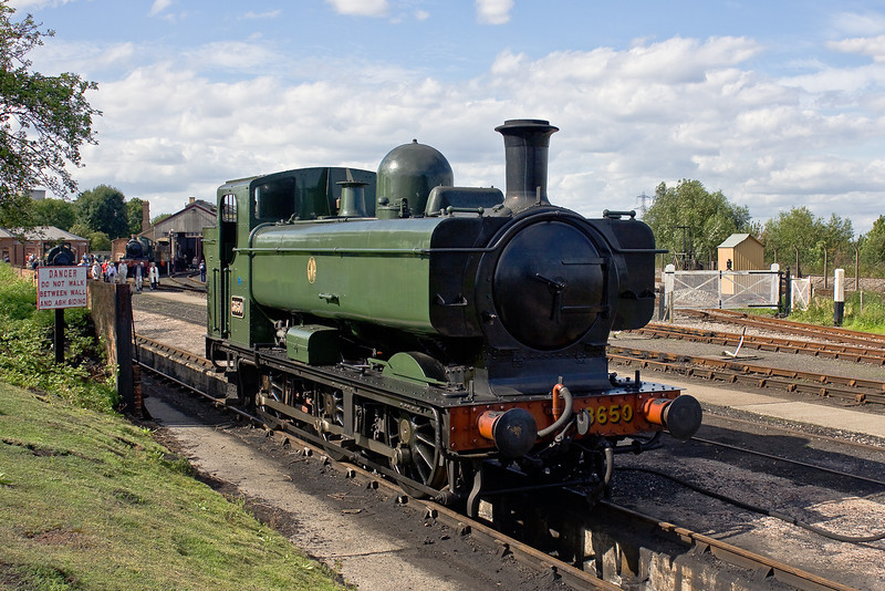 29th Aug 09:  Now repainted into GWR Middle Chrome Green and with the 'Shirt button' style of monogram 13650 stands on the coal road