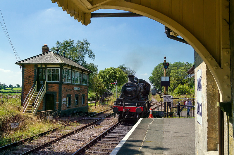 8th Aug 2015:  46447 and the Signal Box at Cranmore.  The style of GWR box was erected around 1900 and was I think the most handsome of all their designes.