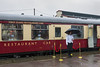 23rd Mar 13:  Despite the weather the attendants  were standing their ground to welcome customers aboard the The first train of the day, the 09.30 Pullman to East Grinstead