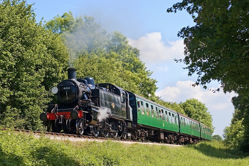 2nd Jun:    41312 is barking well as she climbs through Chawton Woods with the first sevice of the day from Alton