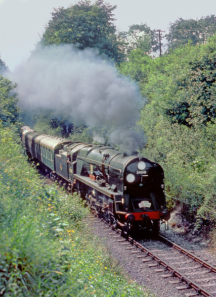 """16th Jul 83:   Rebuilt Bullied Pacific 34016 """"Bodmin"""" blasts out of the cutting and away from Alresford"""