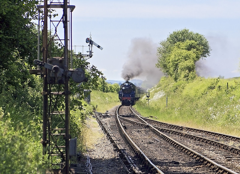 2nd Jun 07:  The signalman has just cleared the road and 73096 will open up again to climb the last few yards to Ropley Station