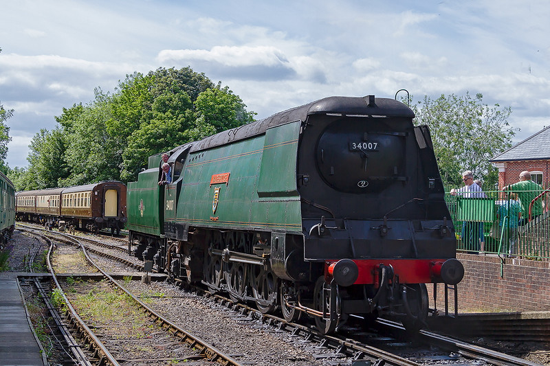 27th Jun 2015:  West Country Pacific 34007 'Wadebridge' starting to run round  at Arlesford so that it can power the 15.45 to Alton