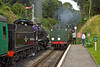 29th Aug 11:     The fireman of 73096 echanges the token at Medstead & Four Marks  as the crew of 31806 look on.