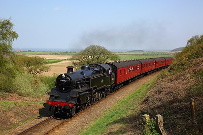 Standard Class 4 Tank No  80072 visiting from Llangollen, works the 1302 Sheringham to Holt at Kelling Heath on the 22nd April 2018