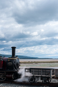 Steam loco and estuary view