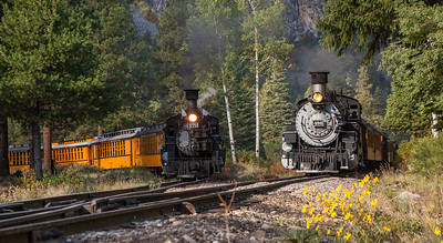 "Our train, the 476, on the left, parked on the ""Y' to let the regularly scheduled 486 chug on its way back to Durango from Silverton."
