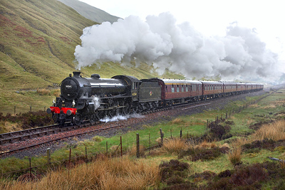 In full monsoon conditions and about 2 hours late, 61264 climbs to County March Summit on 25/05/2006 with 5Z62 0130 Carnforth-Fort William Yard. The train was the ECS for the 2006 Jacobite season. The train eventually arrived in Fort William 198 minutes late.